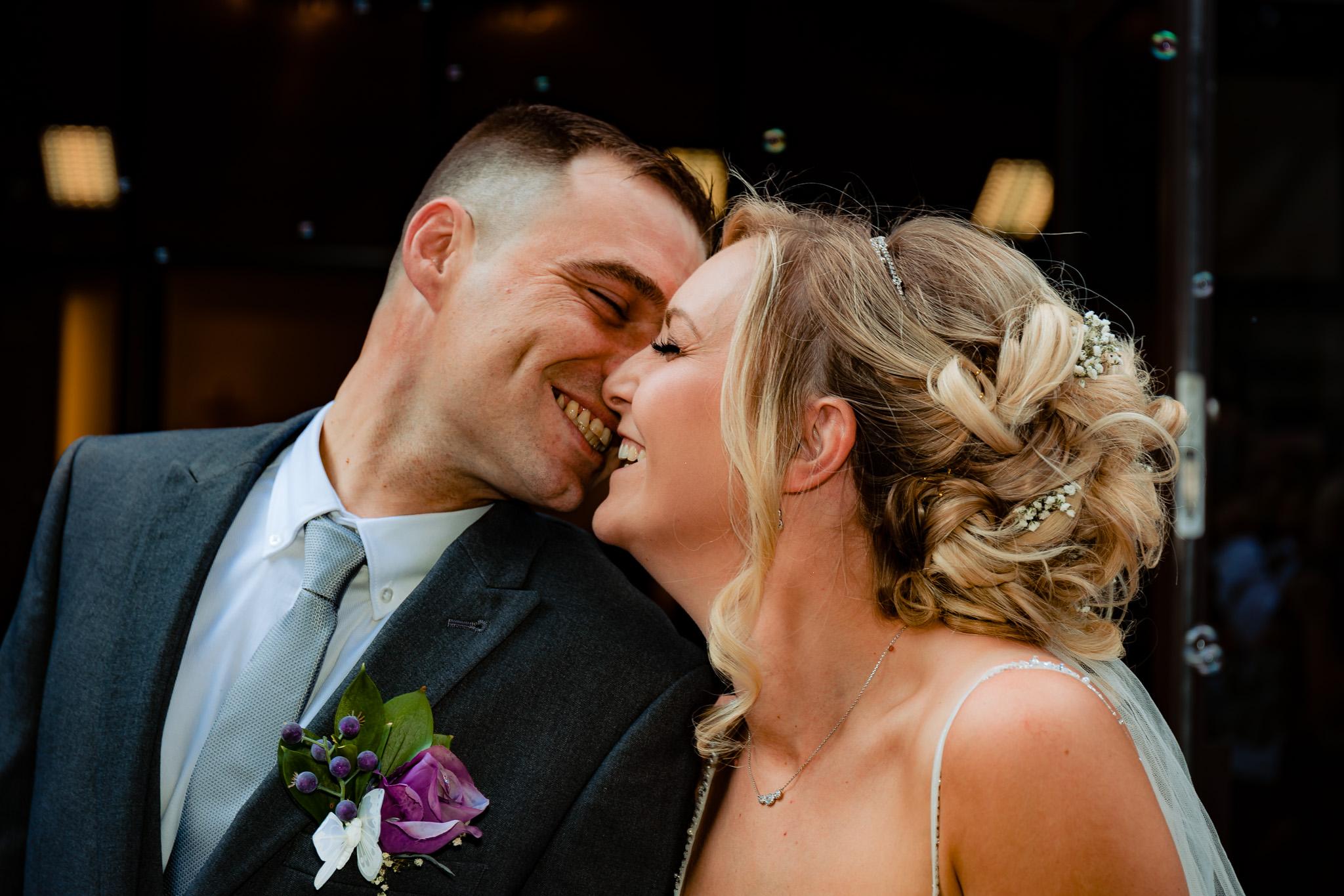 Leeds wedding photography of couple kissing